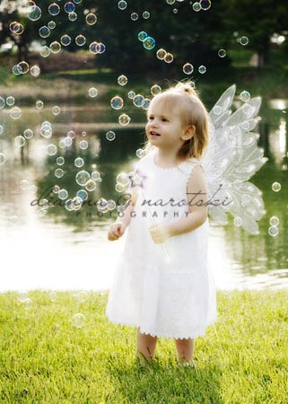 photograph of child with fairy wings