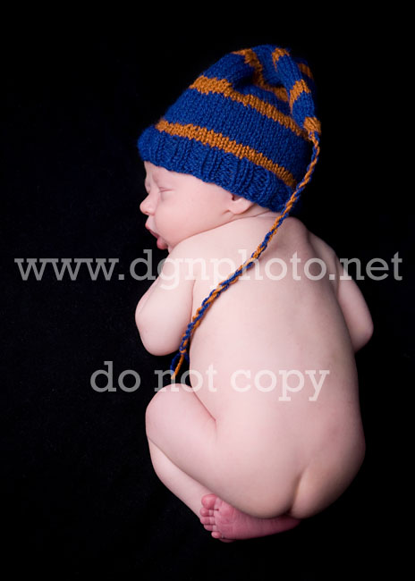 baby wearing a tassel hat