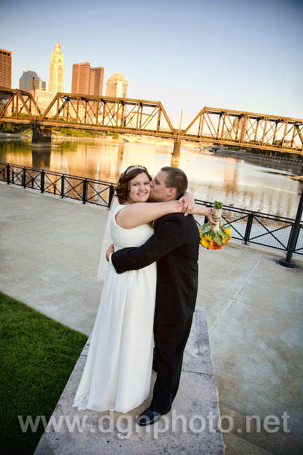 The newlyweds in front of the Columbus skyline at North Bank Park
