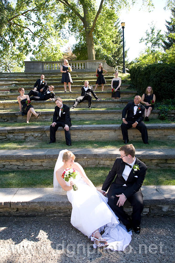 The wedding couple doing a fun picture with the bridal party at the amphitheater at the Ohio State University