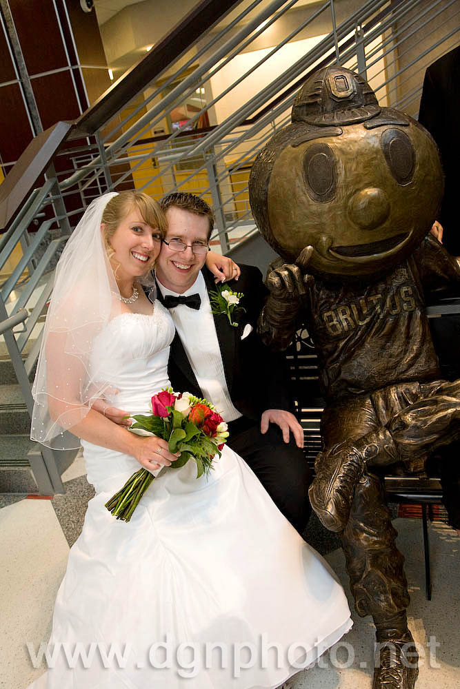 The happy couple poses with the Brutus Buckeye statue at the Ohio Union