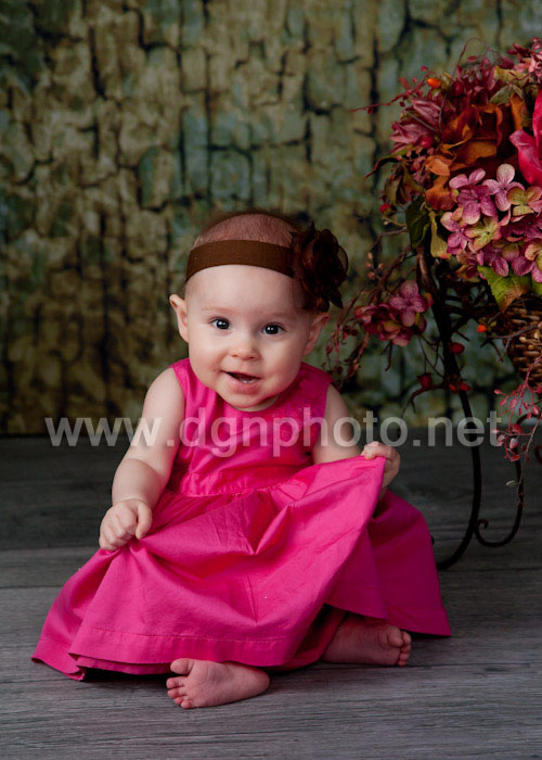 baby in a pink dress
