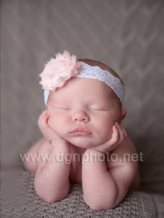newborn baby girl sleeping up on hands