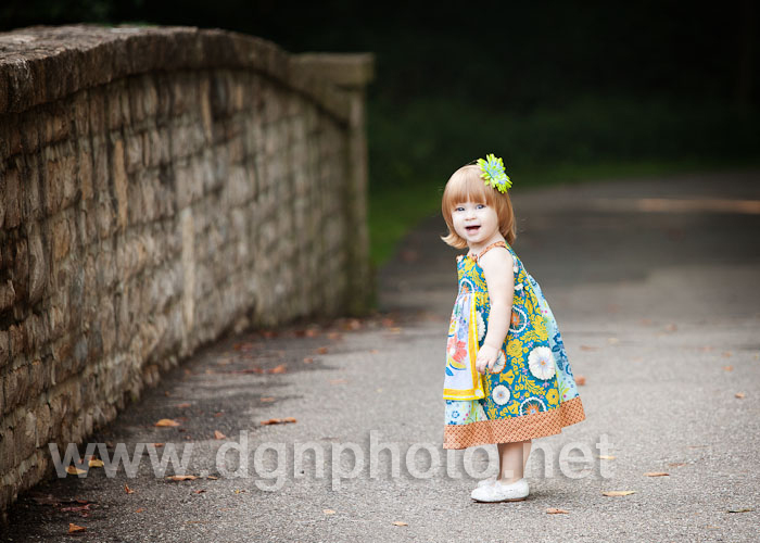 Miss D wearing her Lottie Da dress (that matches her strawberry-blonde hair), on the bridge at Inniswoods Park