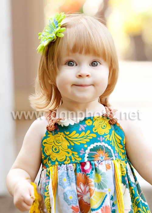 And here is a close up, just to show I did take some.  I love the adorable expression on her face, and you can really see how blue and sparkly her eyes are! (I also couldn't get over how adorable that dress is, she wears it well!)