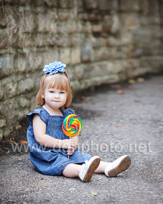 Here is one of my favorite photos of Miss D with her lollipop. (It has something like 1000 calories so I don't recommend eating the whole thing!)